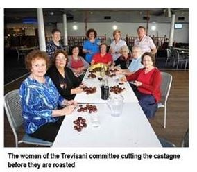 The women of the Trevisani committee cutting the castagne before they are roasted